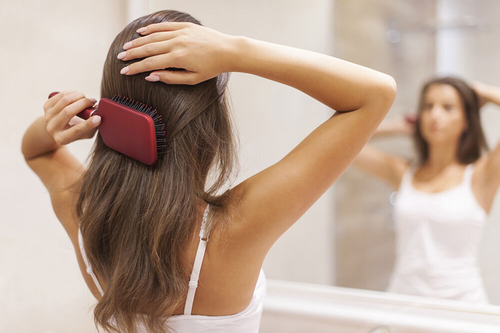 brunette female brushing her hair