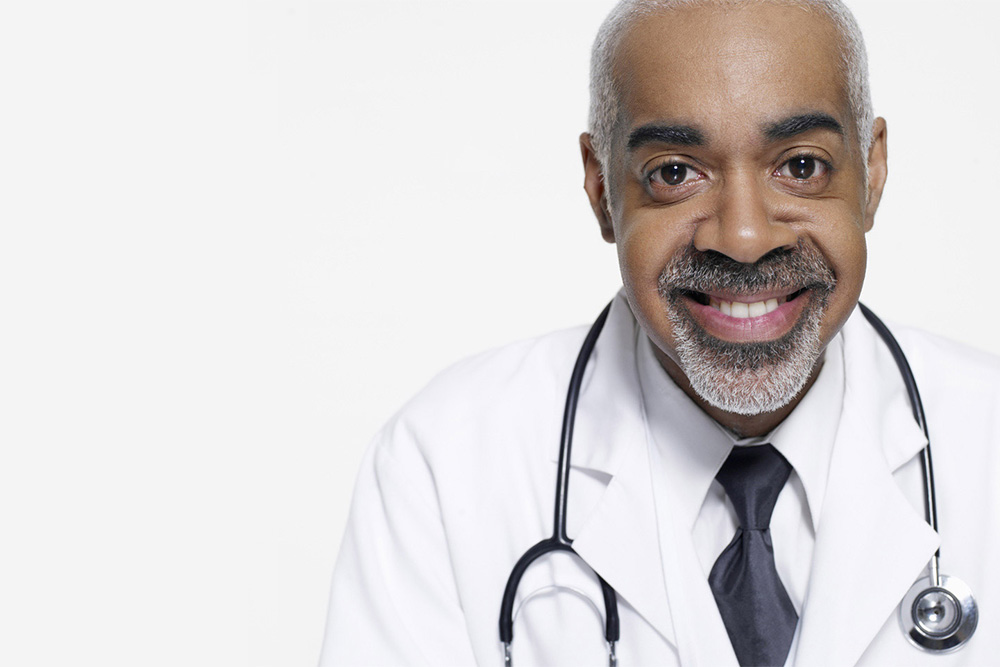 doctor with a black die and stethoscope over his neck